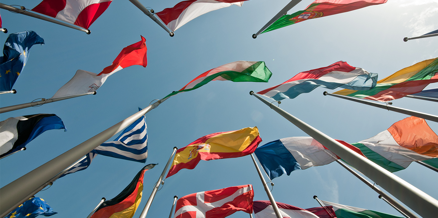 image looking up a group of European countries flags flying together