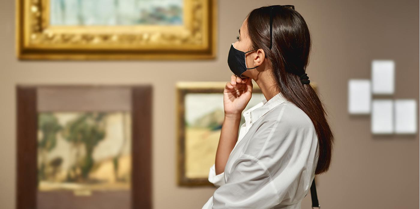woman wearing a mask in art gallery
