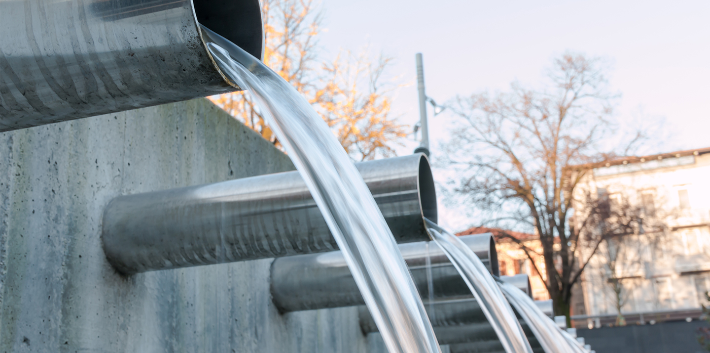 water flowing from steel pipes