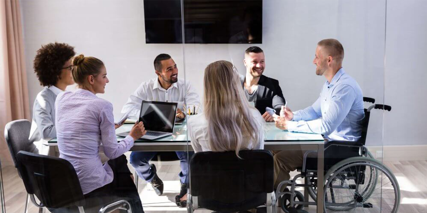 group of individuals with disabilities around a meeting table