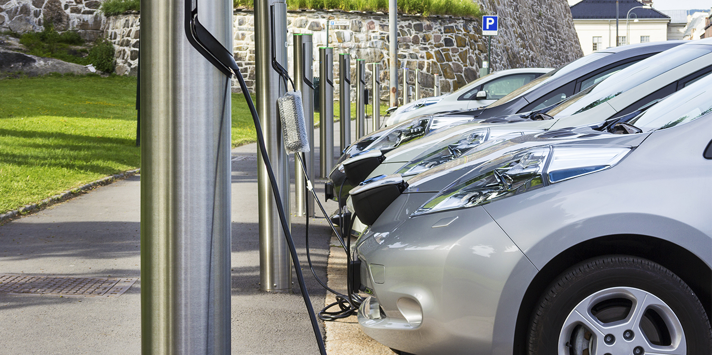 line of electric cars on charge