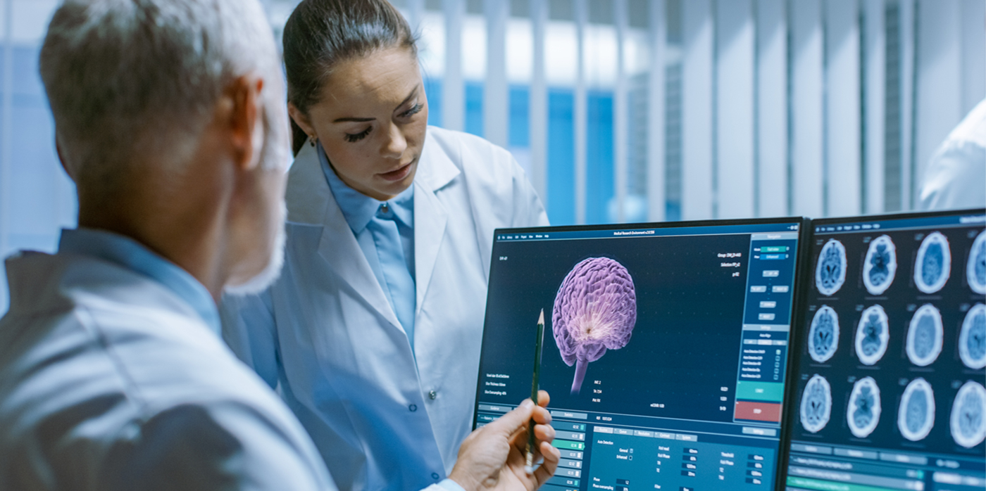 Medical staff looking at image of a brain scan