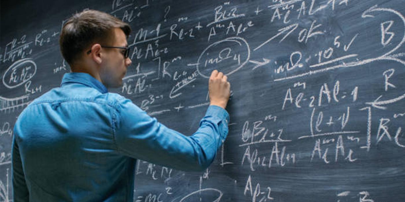 scientist writing formulas on a blackboard
