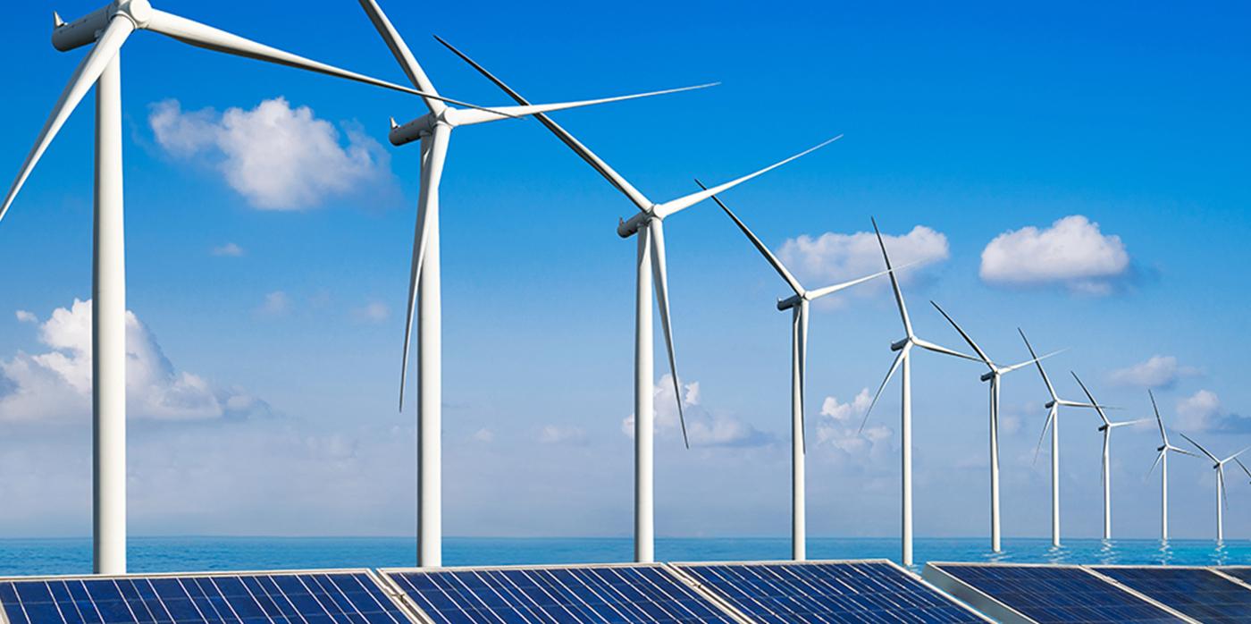 a line of wind turbines wih solar panels underneath