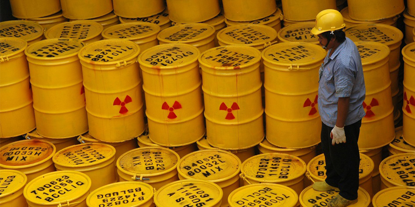 yellow barrels with toxic waste symbol on
